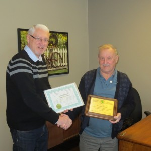 Executive Director of ANBLS presents a 50 year certificate to Don